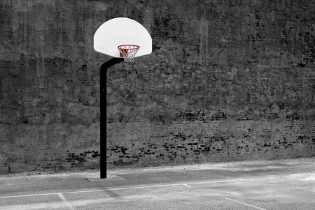 Detail of urban basketball hoop inner city innercity wall and asphalt in outdoor park