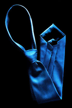 office wear: Closeup detail of blue tie for dressing up with suit and white shirt Stock Photo