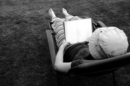 lawn chair: Photo of Person Lounging in Lawn Chair Relaxing and Reading Book