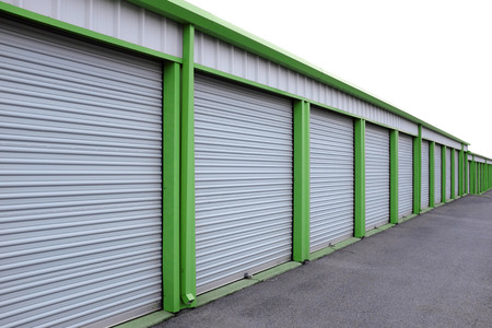 Detail of storage units building with sliding garage style doors Standard-Bild