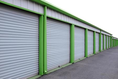 Detail of storage units building with sliding garage style doors Foto de archivo
