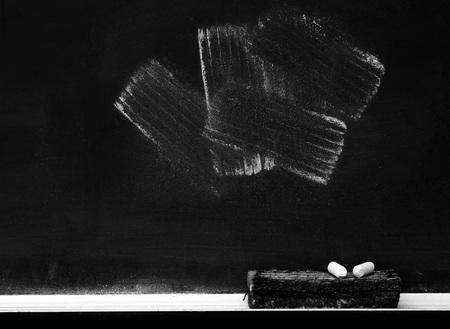 eraser mark: Chalkboard with chalk eraser marks in white chalk