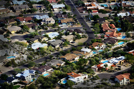 suburban street: Homes houses from high overhead aerial neighborhood development swimming pools and streets