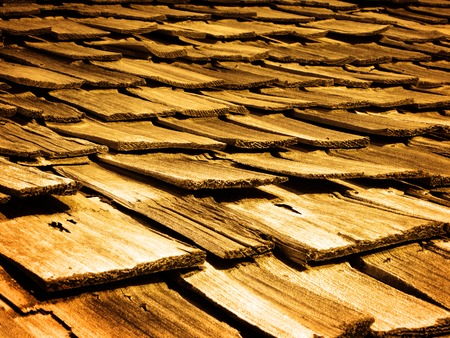 damaged: Detail of old wooden wood shingles on top of house home Stock Photo