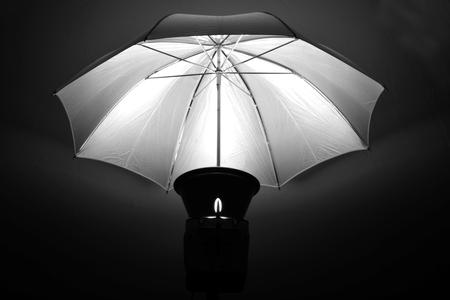 monolight: Studio strobe with umbrella for portraits and photographs