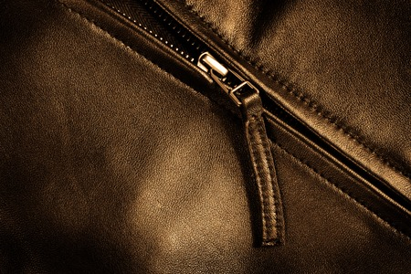 Deep textured leather jacket with silver zipper Фото со стока