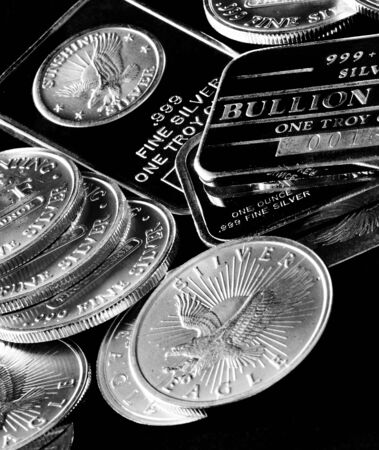silver coins: Silver Coins and Bars to Denote Wealth Stock Photo