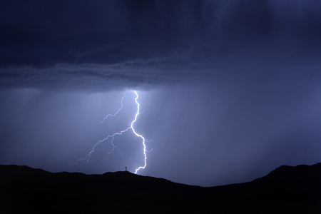 communications tower: Bright lightning bolt on mountain with radio tower for power and communications