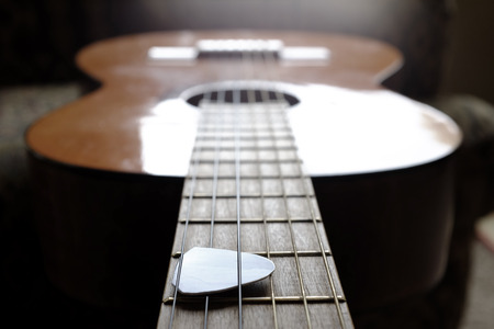 fretboard: Closeup detail of guitar strings for playing music