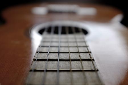 strat: Closeup detail of guitar strings for playing music