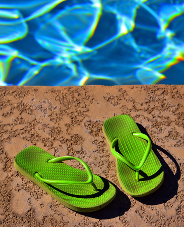 flip flop: Flip Flop Sandals by Swimming Pool