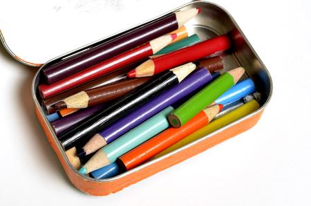 Tin Bin of Colored Pencils Representing Art