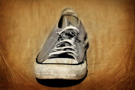 Old shoe worn down shabby for homeless clothing Stock Photo