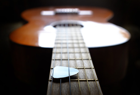 a close up: Closeup detail of guitar strings for playing music