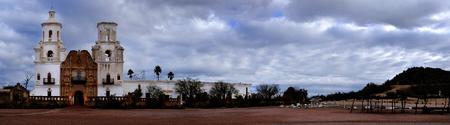 tucson: San Xavier mission in Tucson Arizona christian church with cross Stock Photo