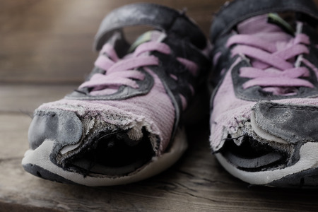 old shoes: Old shoes with holes worn down shabby for homeless clothing