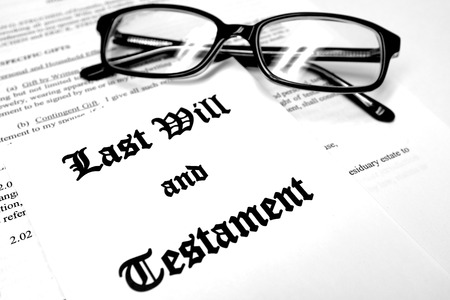 decease: Envelope with Last Will and Testament and Reading Glasses