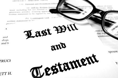 planned: Envelope with Last Will and Testament and Reading Glasses