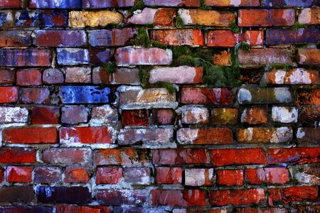 falling apart: Colorful old bricks on wall that is falling apart Stock Photo