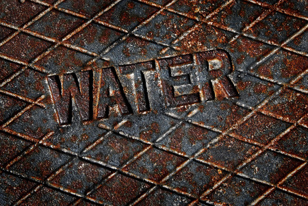 municipal utilities: Water cover lid manhole utility pipes service