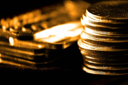 goldbars: Pile of old coins and bullion with dark background Stock Photo