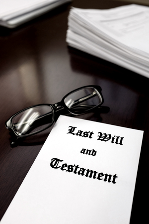 financial official: Envelope with Last Will and Testament and Reading Glasses