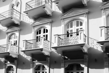 decorative balcony: Detail of old balconies balcony on building with decorative windows and doors Stock Photo