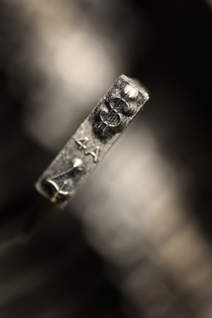 Detail closeup of old typewriter striker keys for writing communication