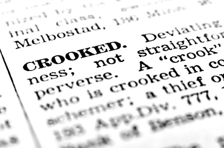 crooked: Closeup definition of crook or crooked person stealing or fraud