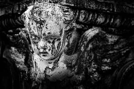 seraphim: Antique marble statue of a Cherub angel with detail of the face