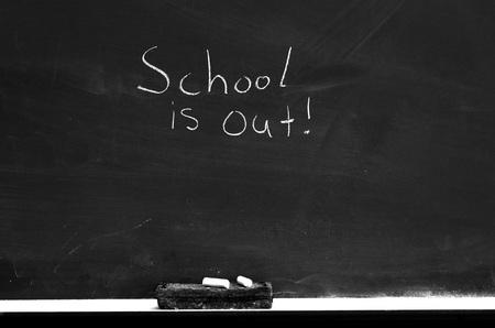 chalk eraser: Chalkboard with chalk eraser marks in white chalk
