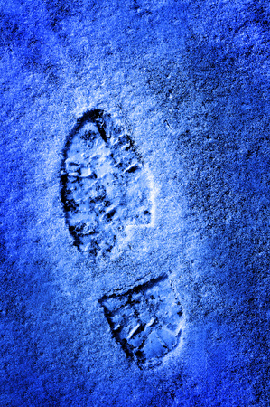 shoe print: Footprint in the snow winter time treking hiking Stock Photo