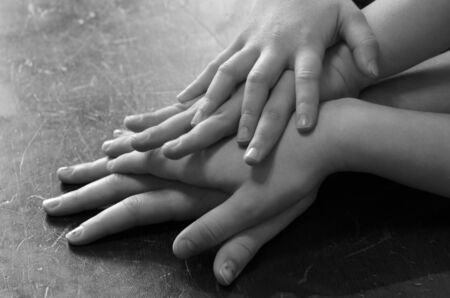 stacked up: Family hands stacked up together in love and unity
