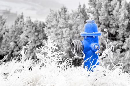 water frozen: Winter Fire Hydrant with Snow and Frost Around Stock Photo