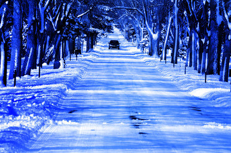 Roadway in the Winter with Car Driving in Snow