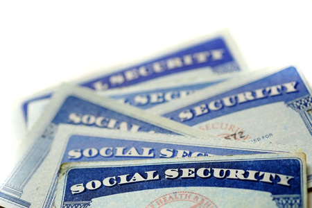 seguridad social: Closeup detail of several Social Security Cards representing finances and retirement