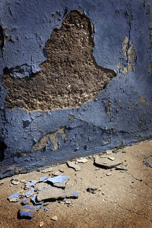 blue wall: Old blue plaster wall crumbled broken pieces Stock Photo
