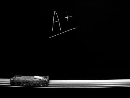 eraser mark: Chalkboard with chalk eraser marks in white chalk A grade