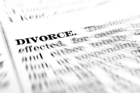 Symbol of broken marriage with word and definition of divorce Stock Photo - 58218013
