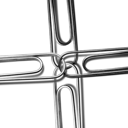 attached: Paperclips attached to represent working together and teamwork
