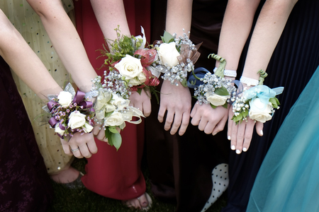 corsage: Girls with Corsage Flowers for Prom Dresses Beautiful Stock Photo