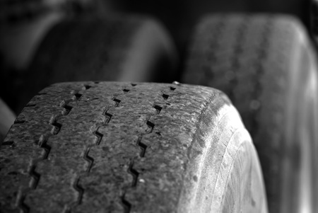 scarred: Detail shot of a large tire for truck or car transportation on road