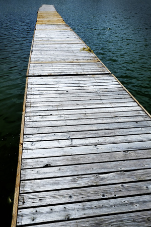 wooden dock: Old Wooden Dock with water shoreline