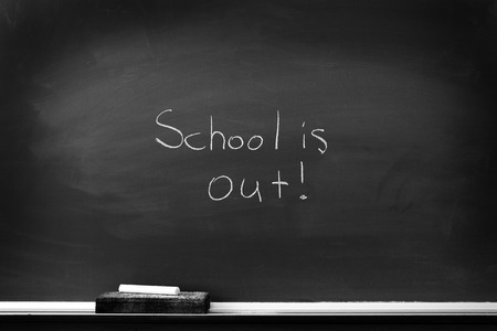 eraser mark: Chalkboard with chalk eraser marks in white chalk School is Out Sign