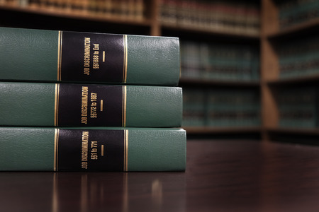 Close up of several volumes of law books of codes and statutes for Job Discrimination Foto de archivo