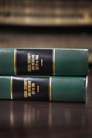 Close up of several volumes of law books of codes and statutes for Social Security