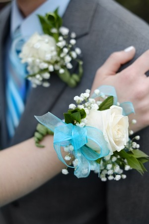 corsage: Hand with Corsage flowers boy girl celebration prom marriage wedding