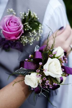 flowers boy: Hand with Corsage flowers boy girl celebration prom marriage wedding