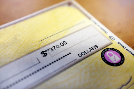 Check written out with payment amount Stock Photo
