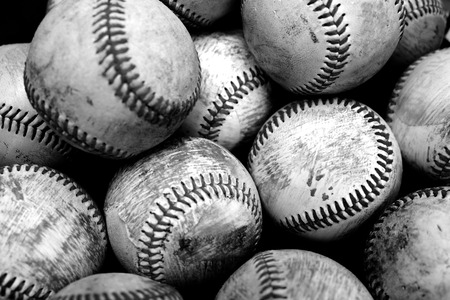 Pile and stack of old worn baseballs for sports and recreation pasttime